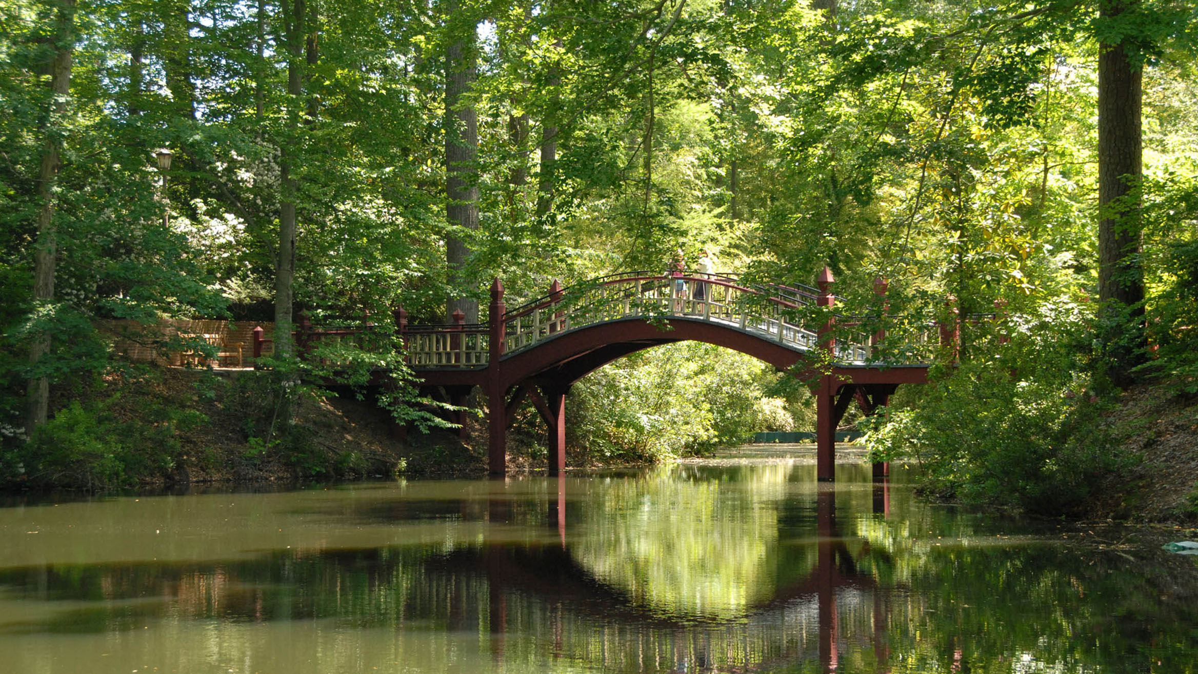 Located in the heart of William and Mary's scenic campus, Crim Dell Bridge is a popular site for students and visitors alike. Lore has it if students kiss on the bridge they will marry each other. Photo courtesy of the College of William and Mary/Scott Elmquist.