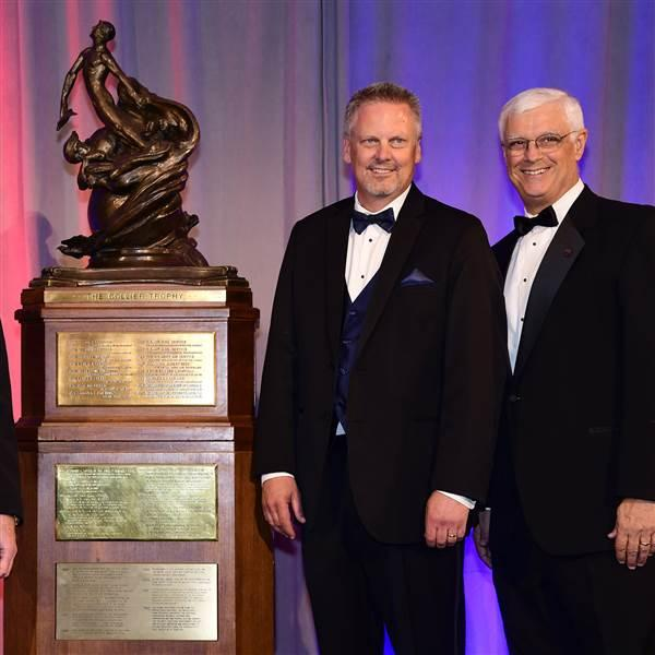 Cirrus Aircraft's Dale Klapmeier, second right, accepted the Collier Trophy for the Cirrus Vision Jet on June 14. Participating in the presentation were National Aeronautic Association Chairman Jim Albaugh, left, Cirrus Aircraft President of Innovation and Operations Patrick Waddick, and NAA President Greg Principato, far right. Photo by David Tulis.