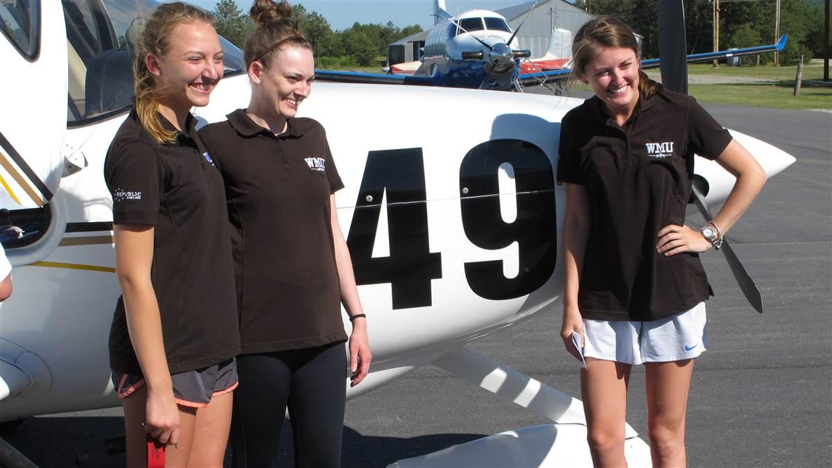 The three members of a flight team from Western Michigan University received a warm welcome in Fryeburg, Maine, after completing the 2018 Air Race Classic on June 21. Lauren Quandt (left), Kelly Erdman (center), and  Shelby Satkowiak flew a Cirrus SR20. Photo by Dan Namowitz.