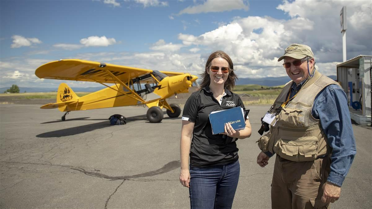 AOPA's Alyssa Cobb receives instruction from McCall Mountain Canyon Flying's Gary Glodowski in the Sweepstakes Super Cub at Slate Creek Strip in Idaho. Photo by Mike Fizer.