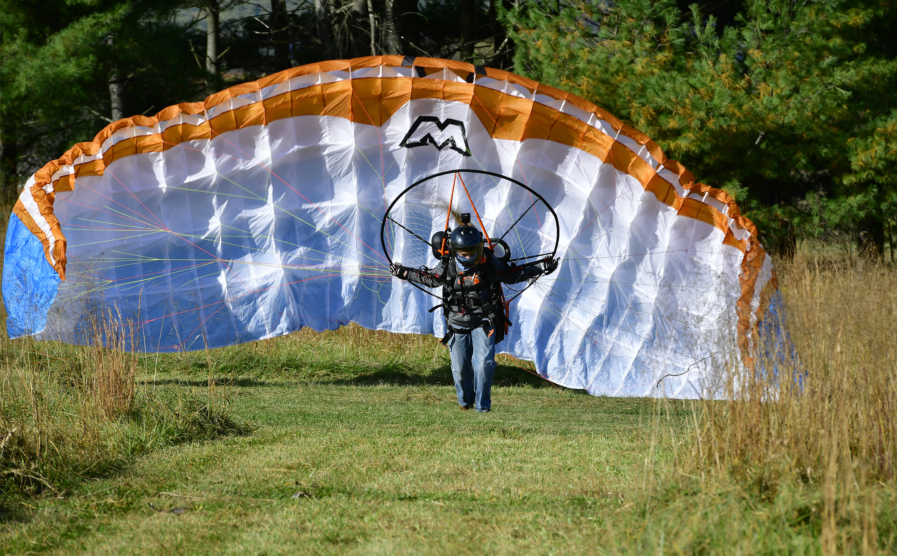 Powered paraglider pilot Henry Scott lifts off from a grass strip in Lovettsville, Virginia. Photo by David Tulis.
