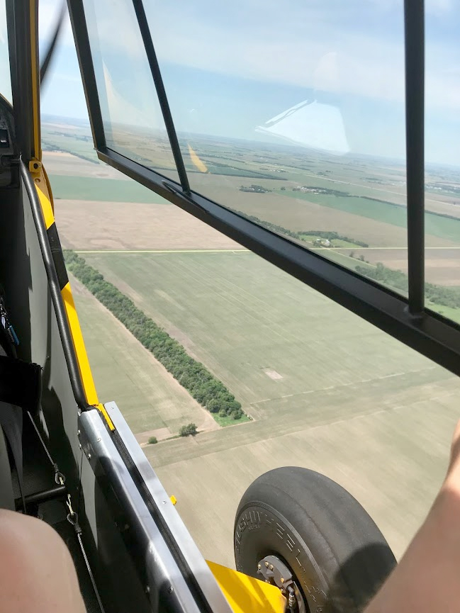Window and door open: Now this is Super Cub flying at its best! Photo by Janet Davidson.