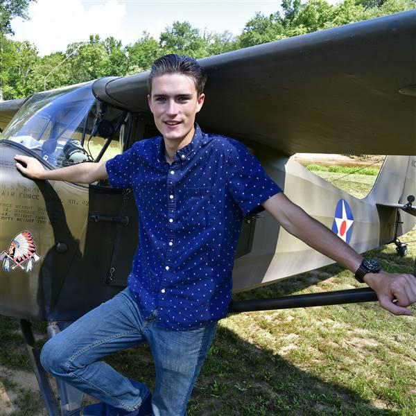 CFI Sean Reagin, 19, pushed his 1939 Aeronca Chief into a parking spot under a stand of tall hardwoods during the Young Aviators Fly-In at Triple Tree Aerodrome in Woodruff, South Carolina, June 8 to 10. Photo by David Tulis.
