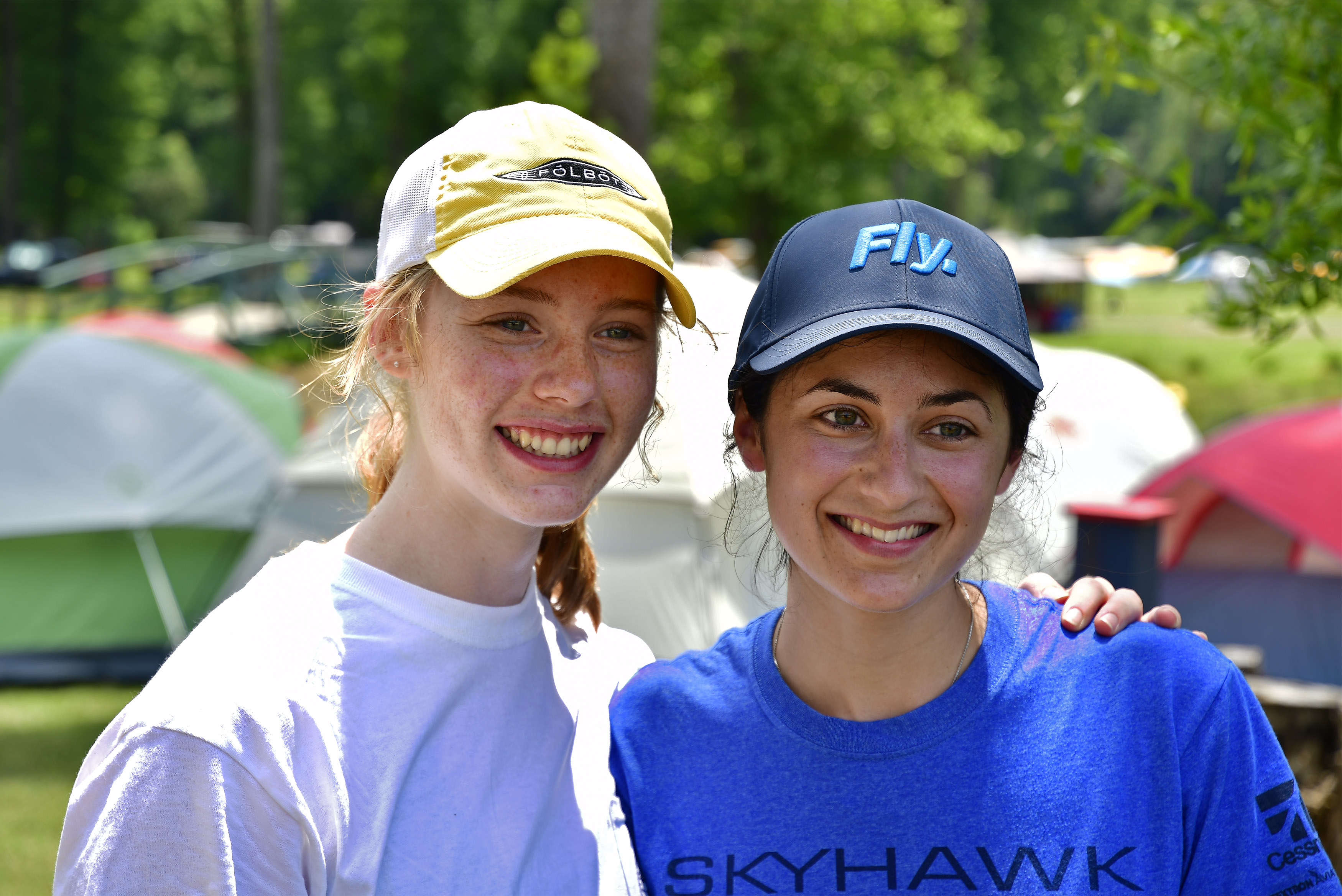 Rachel Enggasser and Malena Modirzadeh volunteered during the Young Aviators Fly-In at Triple Tree Aerodrome in Woodruff, South Carolina, June 8 to 10. Photo by David Tulis.