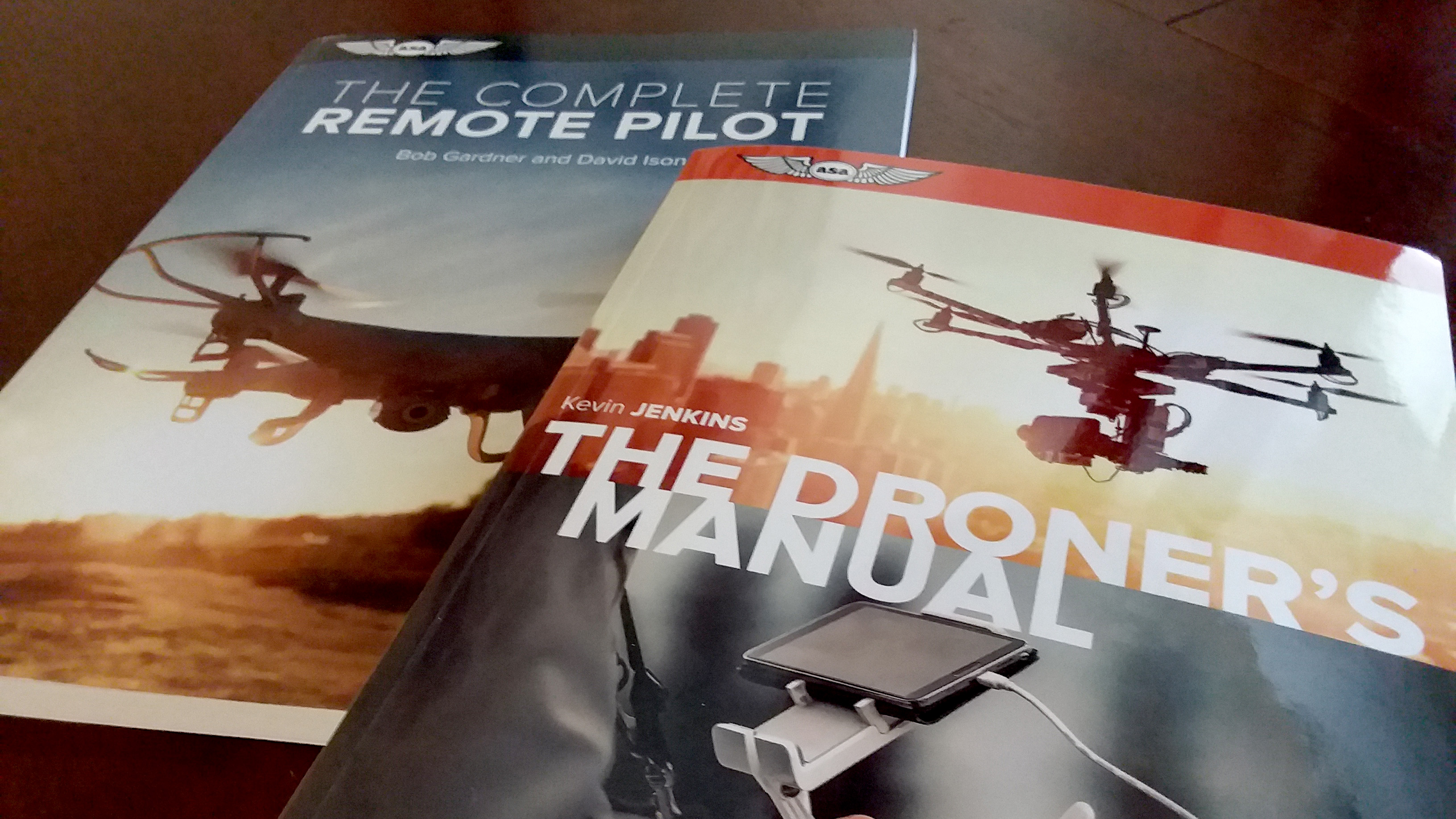 Two new titles from Aviation Supplies & Academics take the drone enthusiast from building your own unit to comprehension of the regulations and how to operate safely in the National Airspace System.
