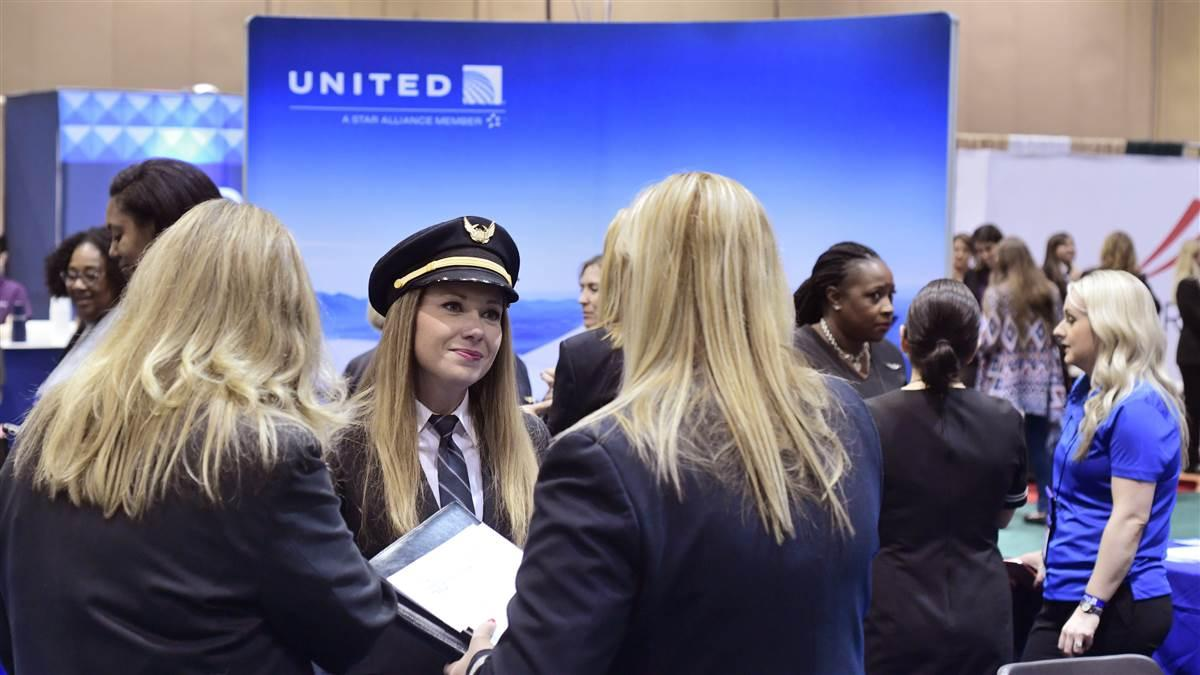 Katrina Mittelstadt, center, a United Airlines Boeing 737 first officer, talks with two potential United pilot applicants during the 2018 International Women in Aviation Conference in Reno, Nevada. Mittelstadt works from the airline's Houston base. Photo by Mike Collins.