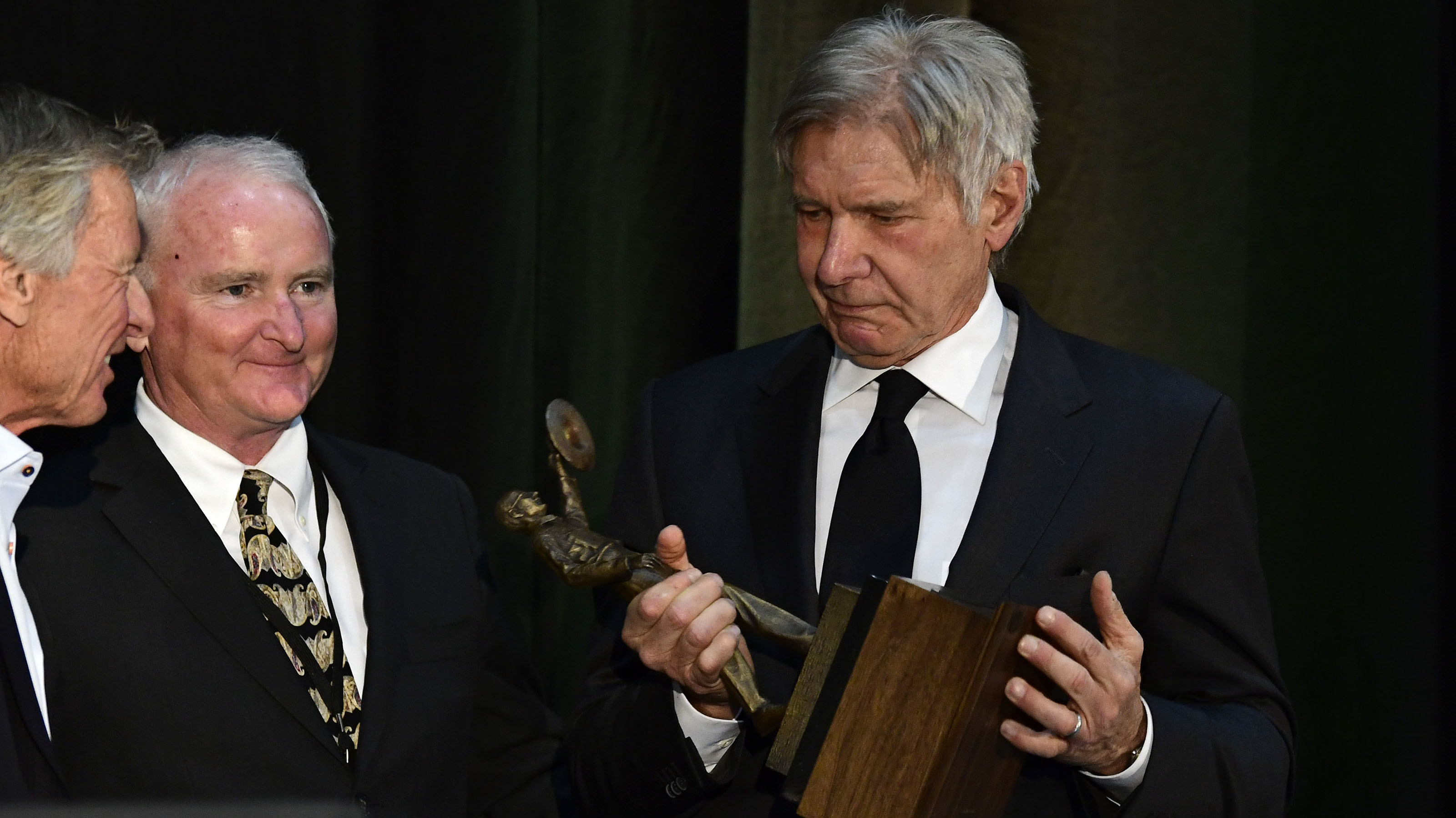 Pilot and actor Harrison Ford accepts the Hoover Trophy for general aviation greatness during the third annual R.A. 'Bob' Hoover Trophy reception presented by AOPA in Washington, D.C., March 21, 2018. Photo by David Tulis.