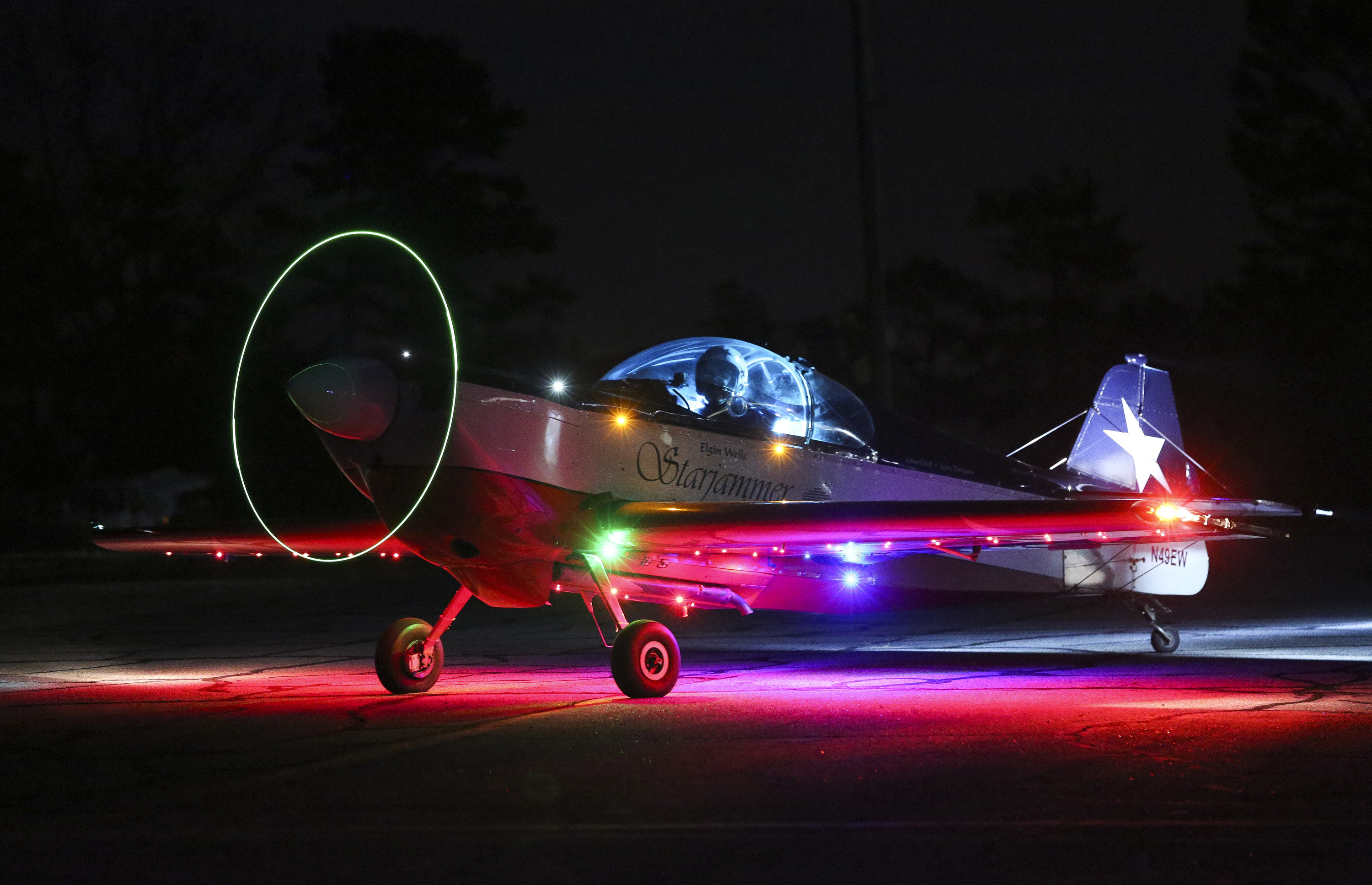Elgin Wells performs a nighttime demonstration in his  aerobatic plane 'Starjammer' at Cherokee County Airport in this 2014 file photo in Ballground, Georgia. The One Design kit airplane is equipped with hundreds of LEDs in order to provide the glow for his night performances. Photo courtesy of the Gwinnett Daily Post.