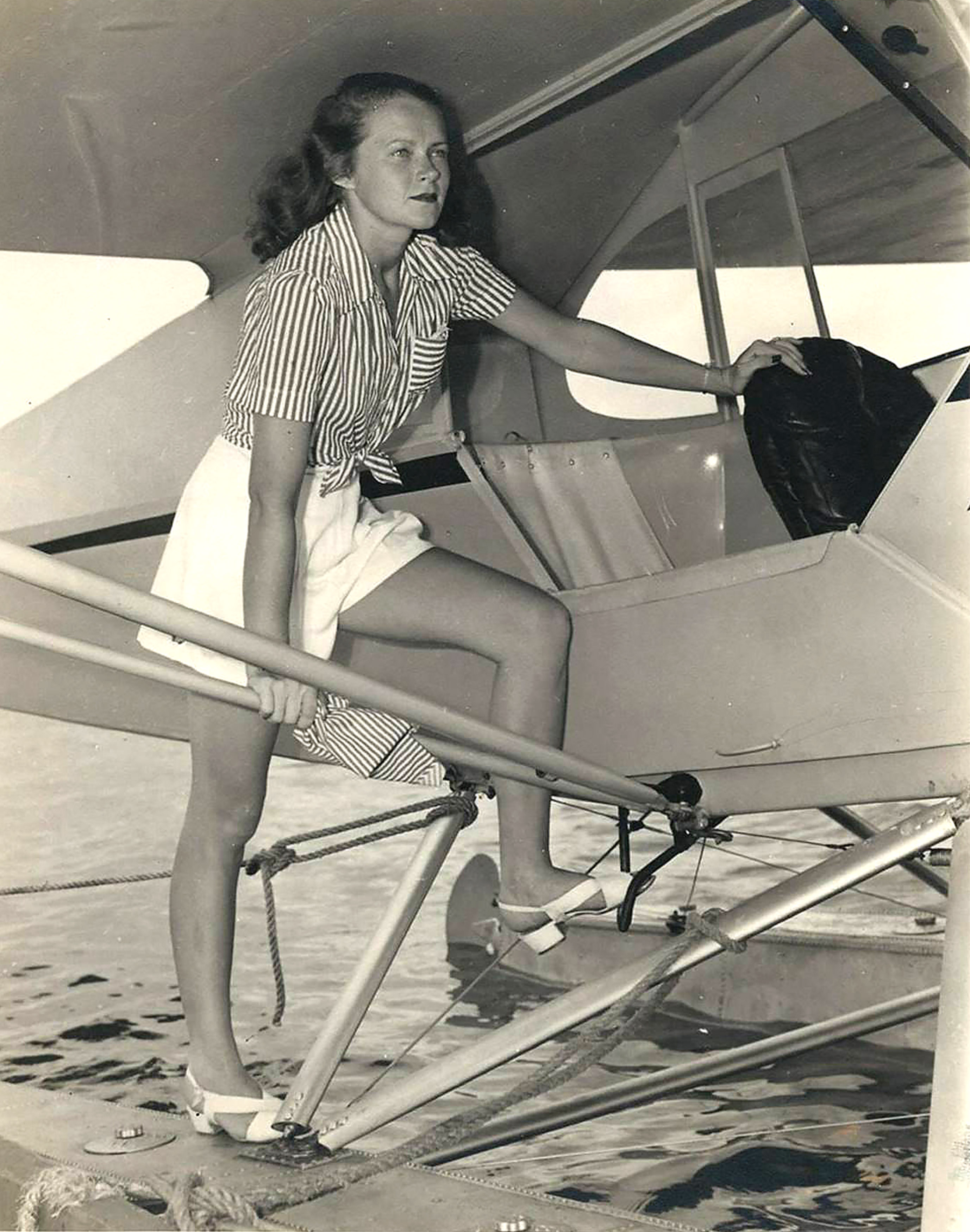 Embry-Riddle pilot Corinne Smith flew the same Piper Cub floatplane on the same day that John F. Kennedy took training in it during the spring of 1944 in Miami. Photo courtesy of Embry-Riddle Aeronautical University.