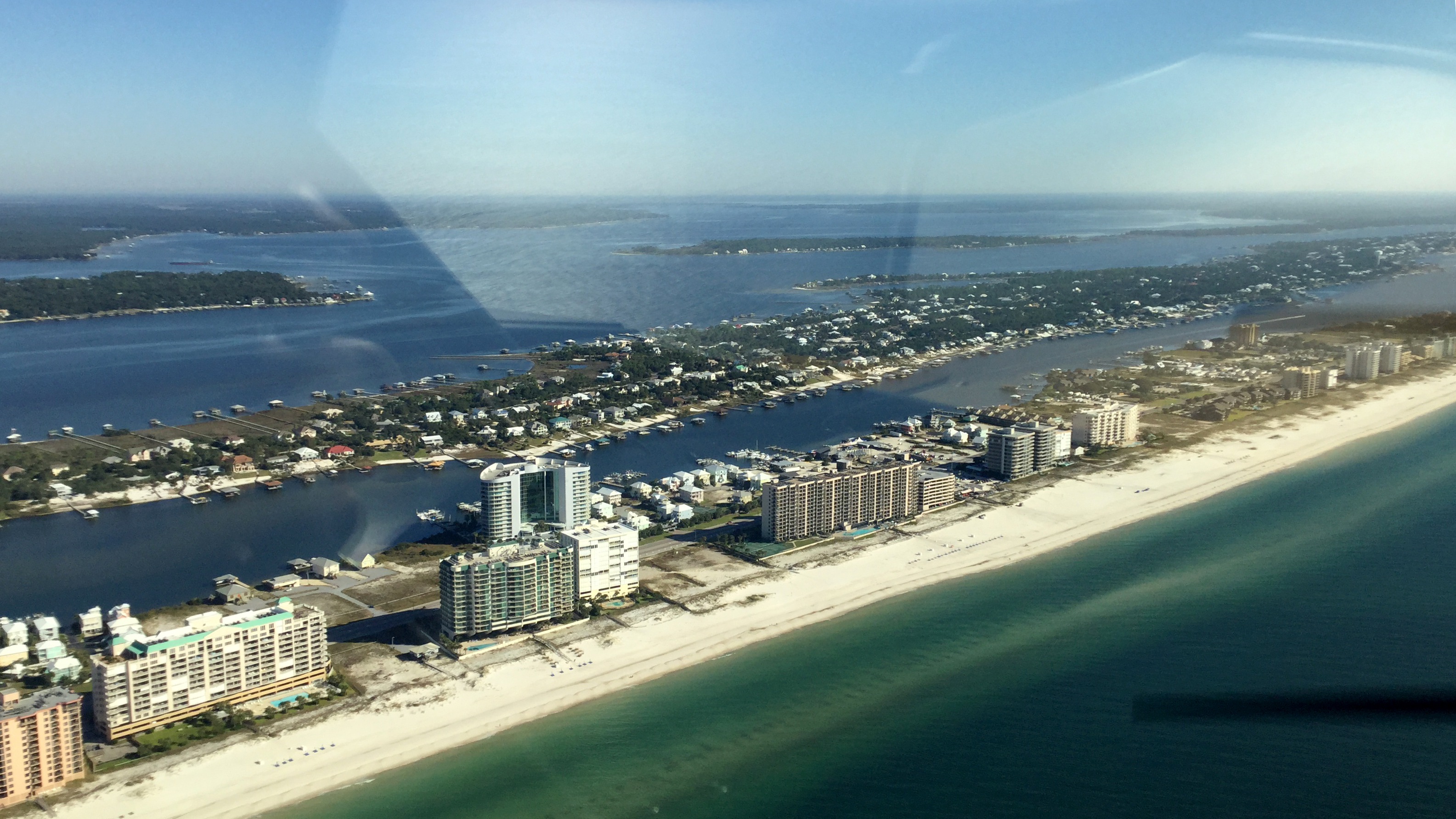 Flying the AOPA Sweepstakes Super Cub along the Gulf Coast at 800 feet provides views of the high-rise condos along the beachfront as well as homes on the Gulf Intracoastal Waterway.