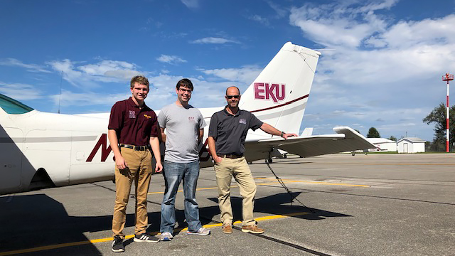 The staff of the FBO at Central Kentucky Regional Airport, where Mark Finkelstein flew his airplane to wait out Hurricane Florence,  includes aviation students at Eastern Kentucky University. Left to right: lineman Alex Montgomery, an EKU flight student; line manager Chris Harover; and airport manager Jason Bonham. Photo courtesy of Cory Hurst.