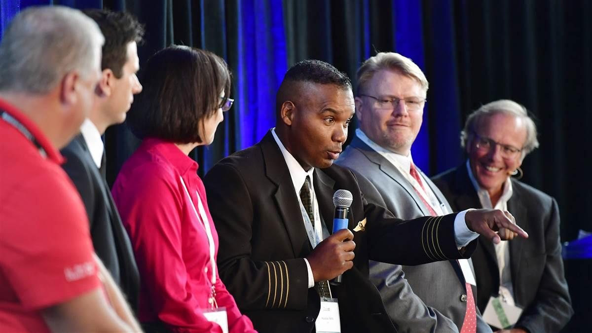 Houston Mills, a UPS captain and director of global aviation and public policy, participates in a hiring panel session during the 2017 AOPA High School Aviation STEM Symposium. Mills will deliver a keynote during the 2018 event in Louisville, Kentucky. Photo by David Tulis.