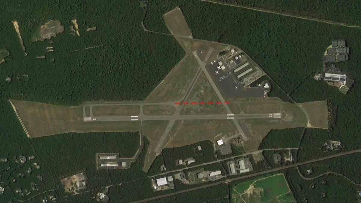 The East Hampton Airport from above with proposed path of construction shown in red. Photo courtesy of Google Earth.