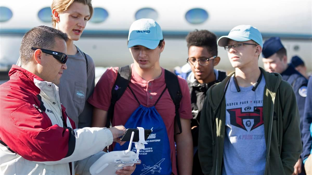 Students learn about drones during the annual Aviation Education and Career Expo at Leesburg Executive Airport in Virginia. Photo courtesy of Alimond Photography, PropJet Aviation.