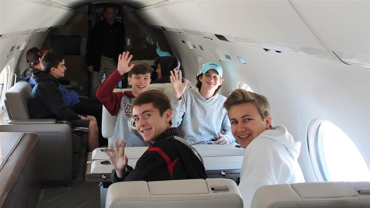 Students sit inside a business jet during the annual Aviation Education and Career Expo at Leesburg Executive Airport in Virginia. Photo courtesy of Alimond Photography, PropJet Aviation.