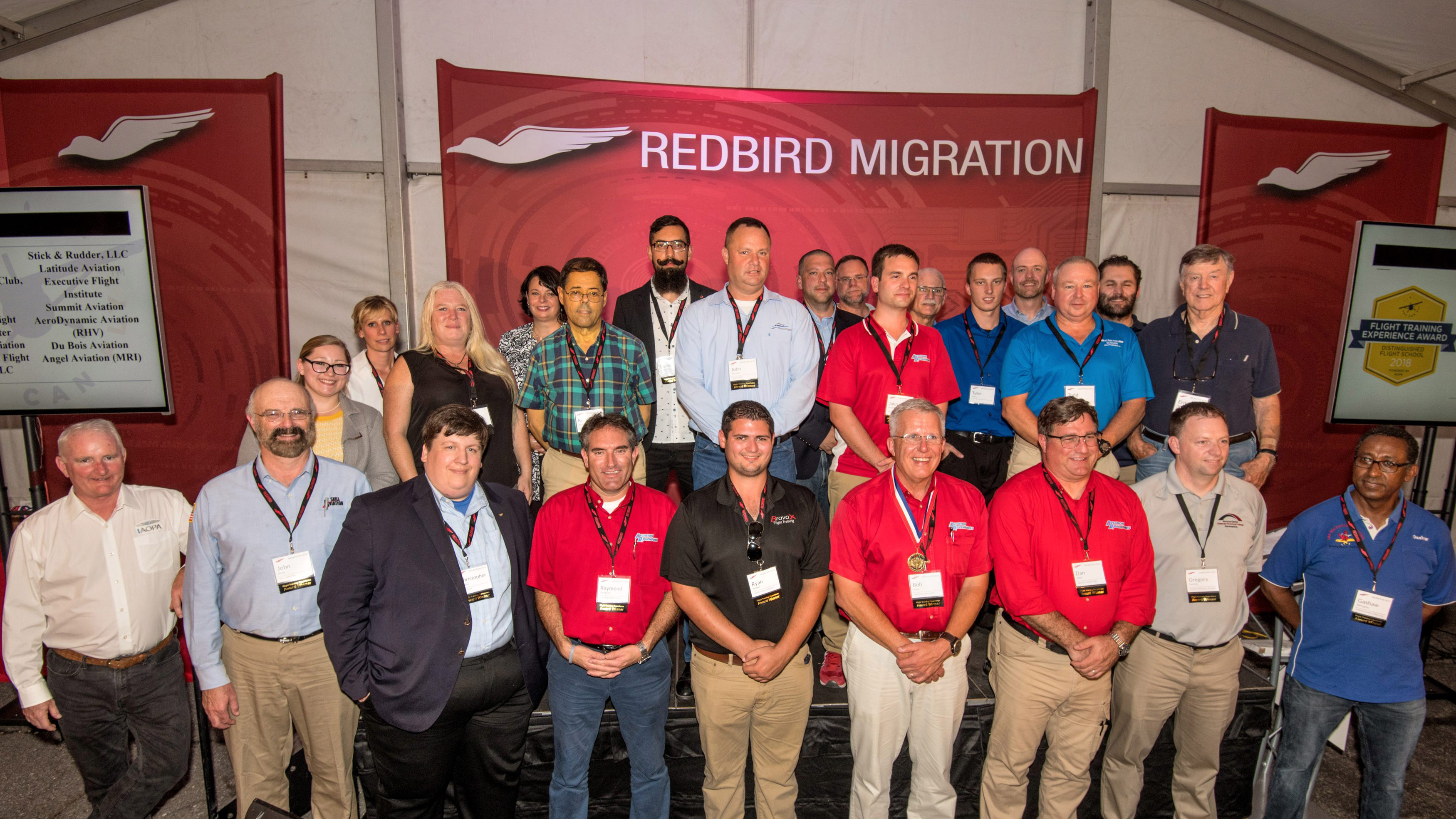 Distinguished regional flight instructor winners join AOPA President Mark Baker and You Can Fly staff members for a group photo during the 2018 AOPA Flight Training Experience Awards presentation at Redbird Migration, held at the AOPA You Can Fly Academy. Photo by Mike Collins.
