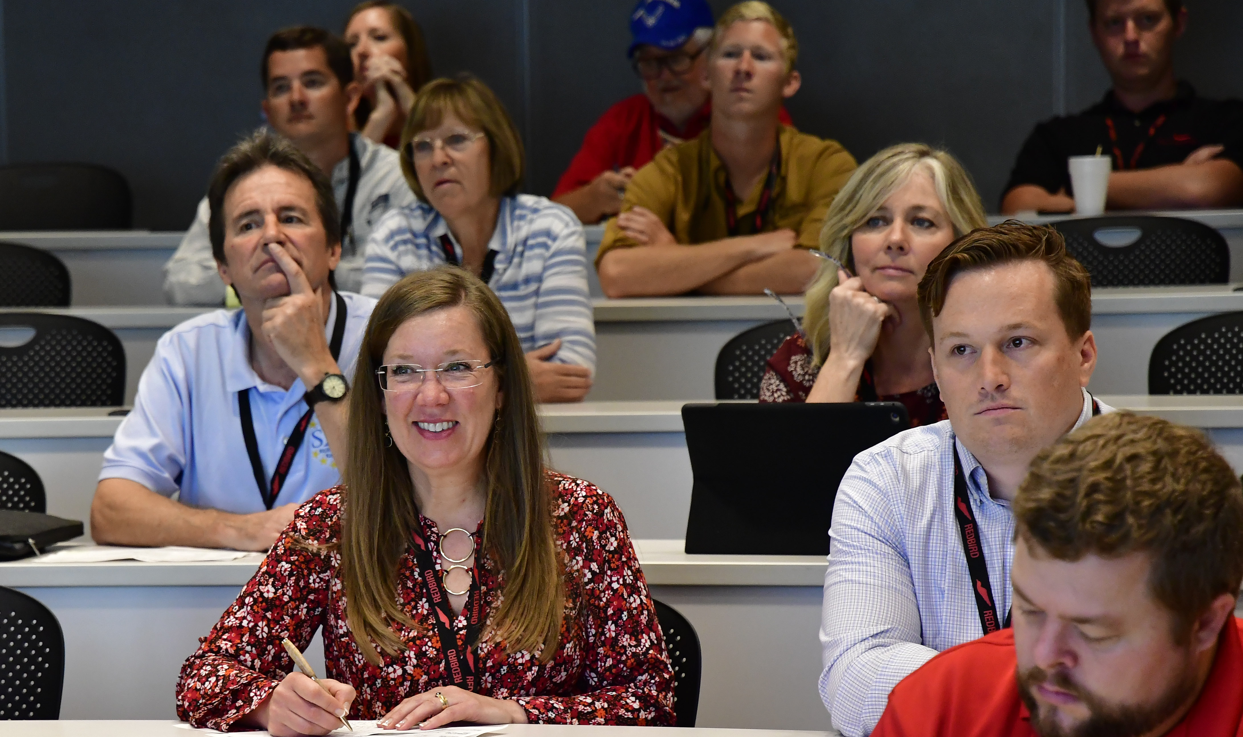 SkyTrek Alaska founder Jamie Patterson-Simes takes notes during a Redbird Migration customer service presentation at the AOPA You Can Fly Academy in Frederick, Maryland, Oct. 10, 2018. She earned the 2017 AOPA Flight Training Experience Award for best flight school. Photo by David Tulis.
