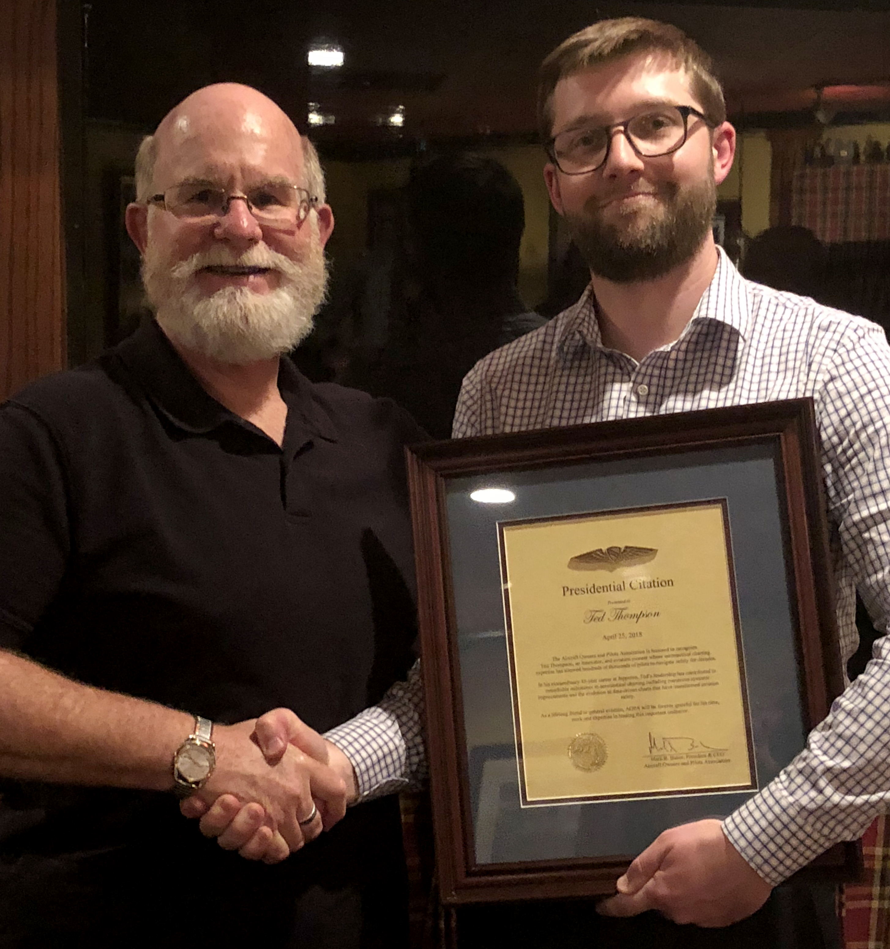 Thompson receives AOPA's Presidential Citation from AOPA Senior Director of Airspace and Air Traffic Rune Duke. Photo courtesy of Rune Duke.