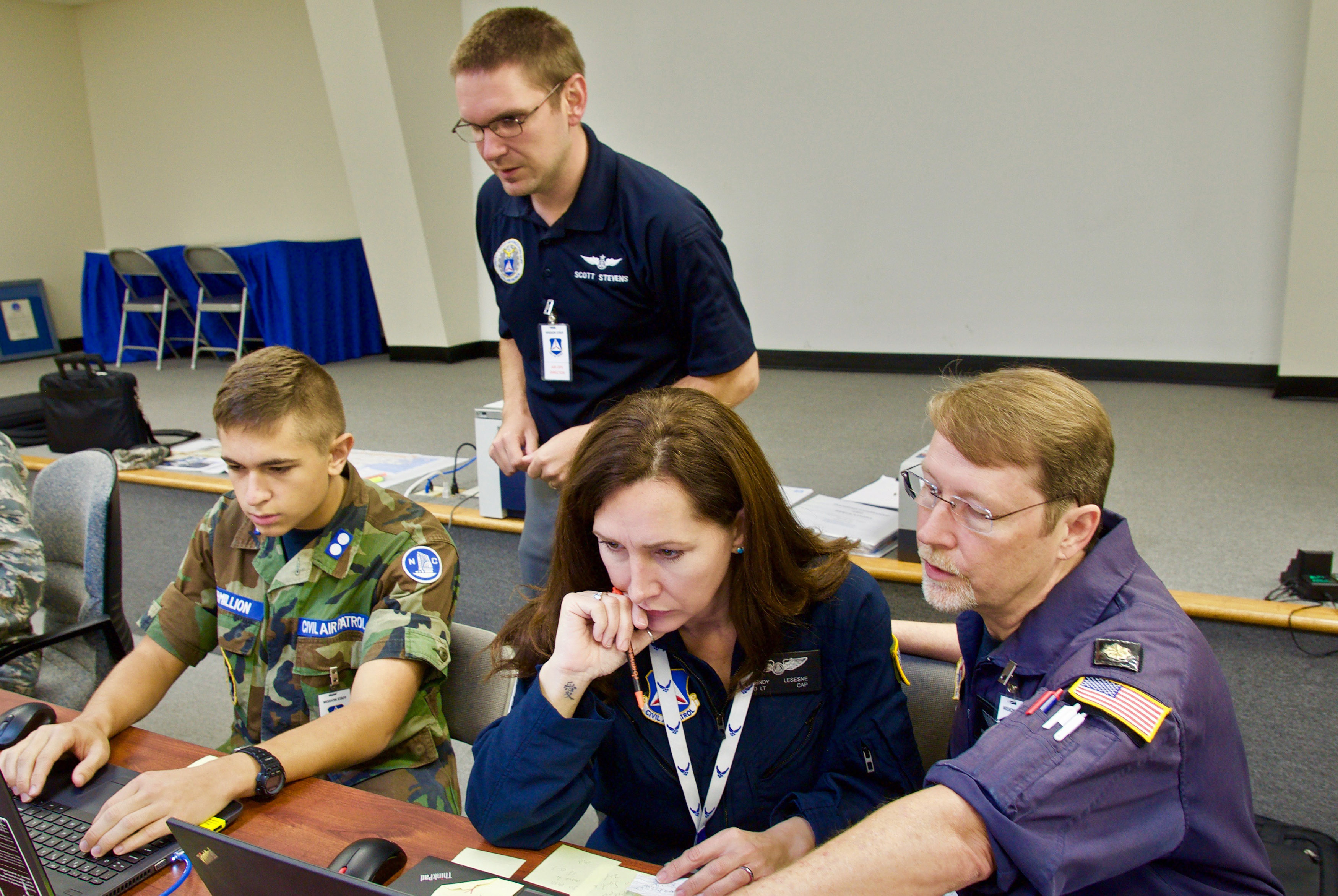 Civil Air Patrol members Isaac Vermillion, Scott Stevens, Wendy Lesesne, and Will Windham (from left to right) work through the flight planning process in the wake of Hurricane Florence at the North Carolina Wing mission base in Burlington. Photo courtesy of the Civil Air Patrol.