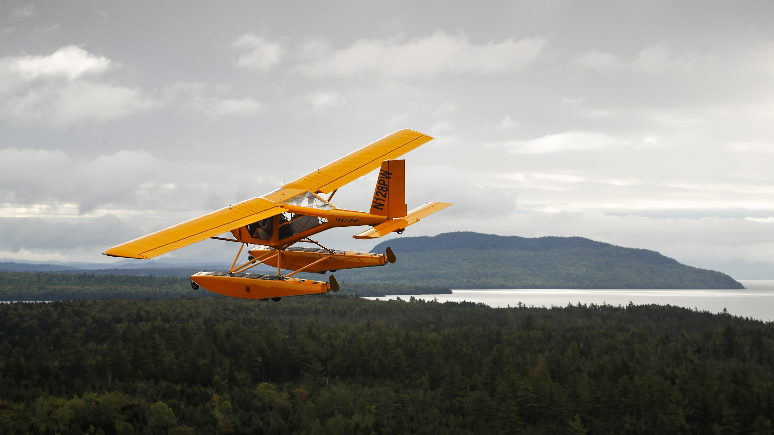 A seaplane flies over Maine's remote landscape heading to Greenville for the International Seaplane Fly-In at Moosehead Lake. Photo by Chris Rose.