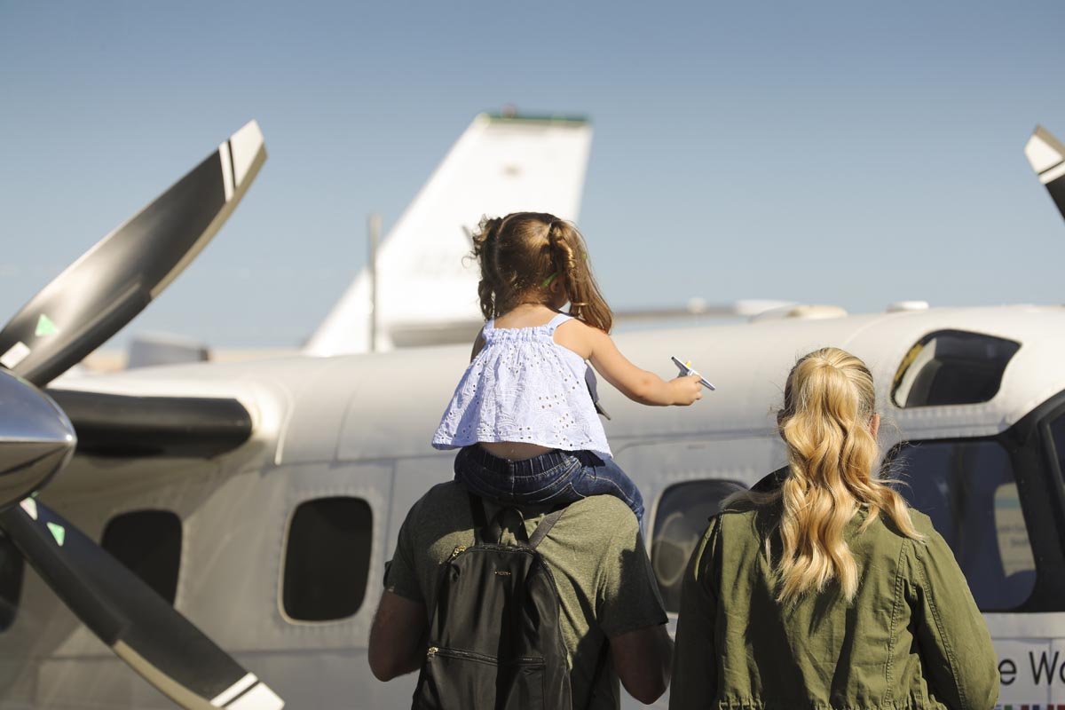 Aviation enthusiasts of all ages enjoy checking out the aircraft on display at the AOPA Santa Fe Fly-In. Photo by Chris Rose.