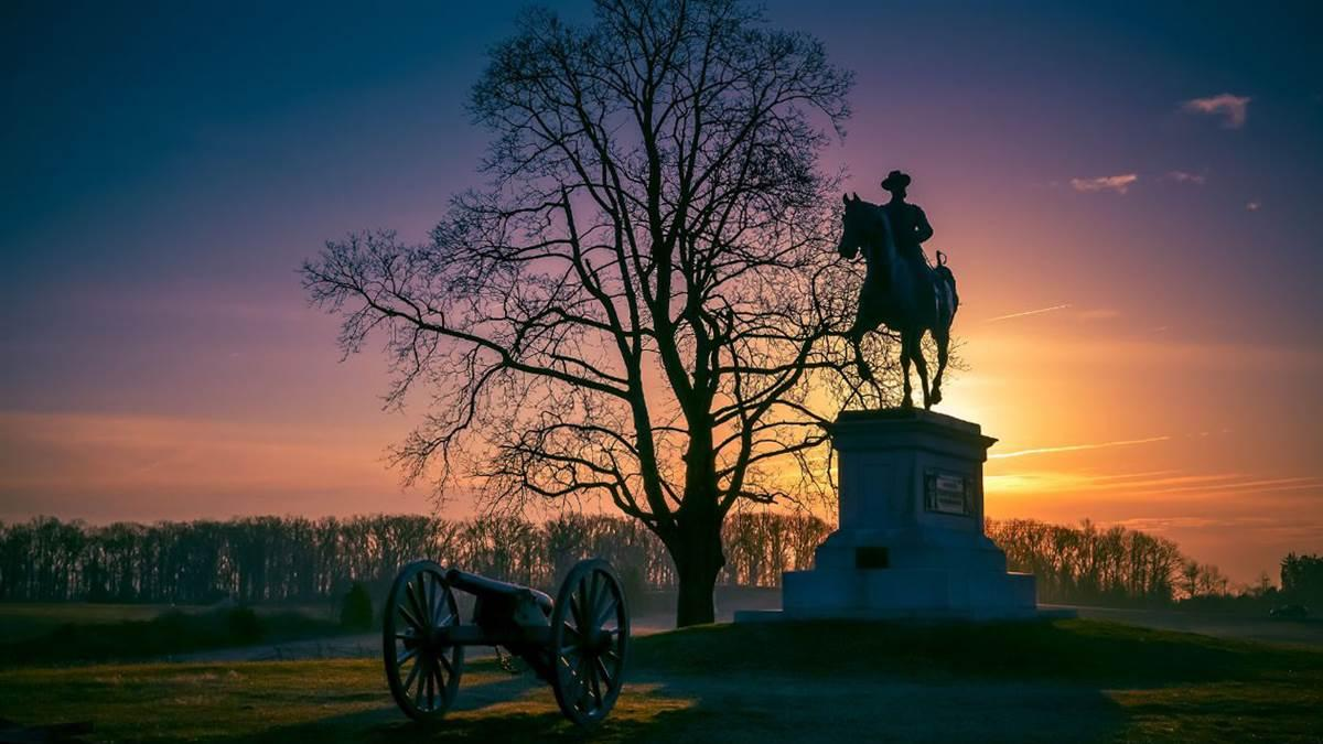 Sunset at Gettysburg National Military Park silhouettes the John F. Reynolds equestrian statue. Photo courtesy of Destination Gettysburg.