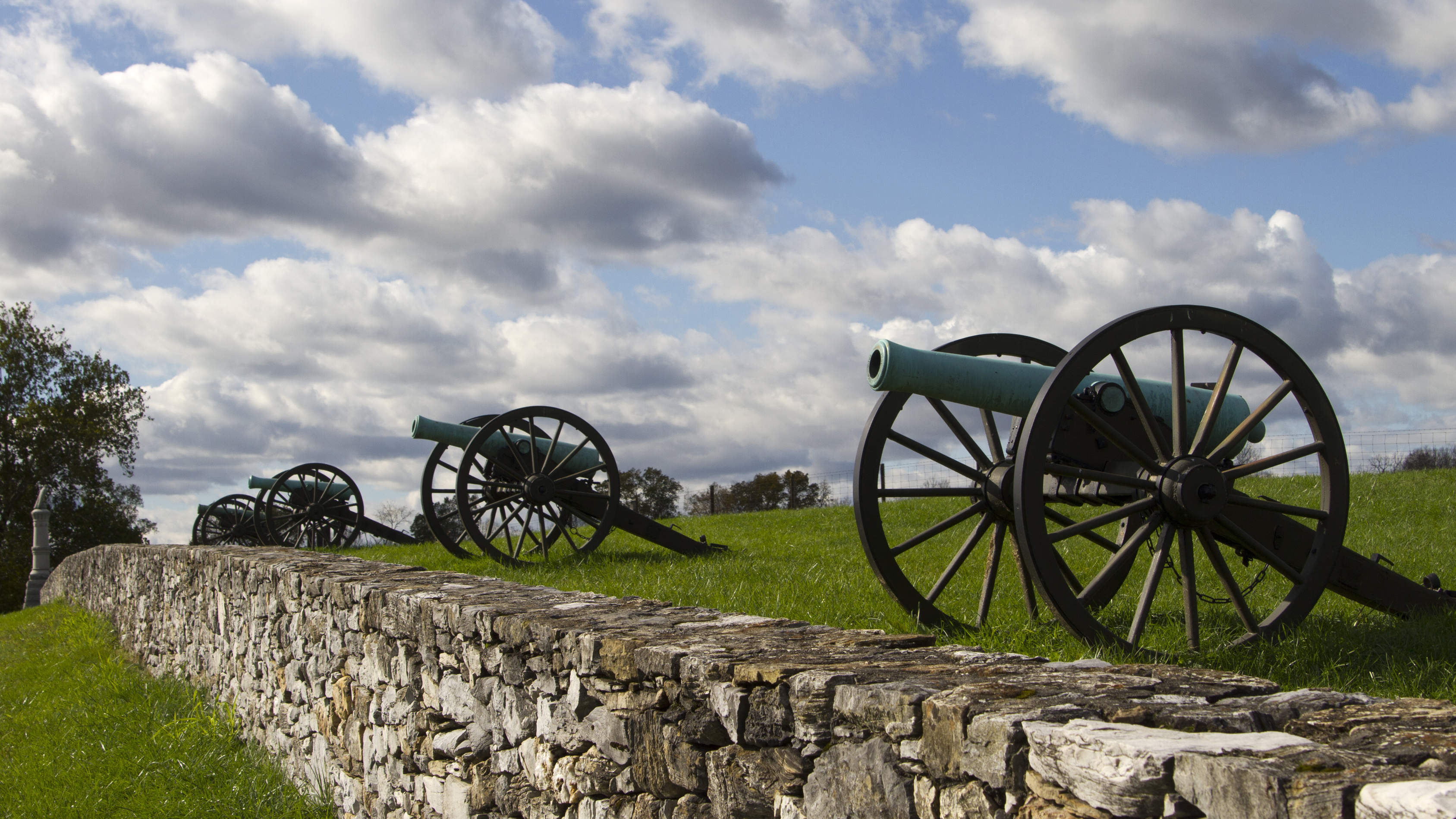 Civil War cannons line a stone wall at Antietam National Battlefield. Photo courtesy of the National Park Service.