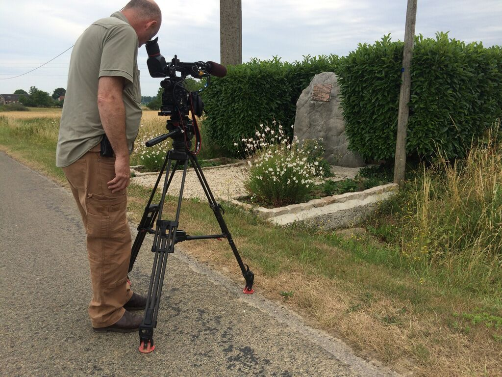Director of Photography Mathieu Mazza films the crash site marker of James McConnell near Flavy-la-Martel, France. Photo by Paul Glenshaw.