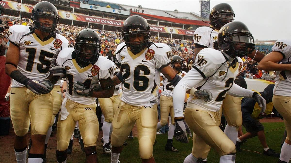 The Wake Forest Demon Deacons run onto the field before facing the Georgia Tech Yellow jackets during an ACC Football Championship game. Photo By David Tulis.