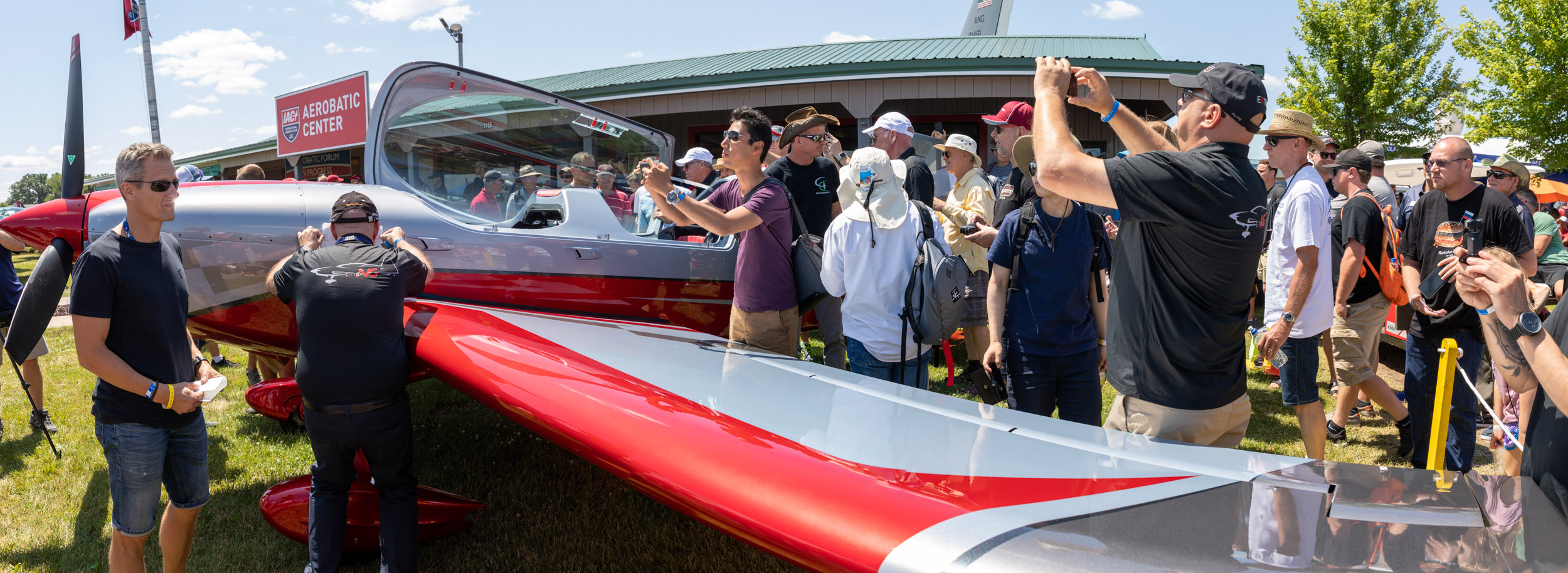 The new all-composite $450,000 Extra Aircraft NG, a departure from Walter Extra's steel frame design familiar to many aerobatic pilots, is unveiled at EAA AirVenture July 22. Photo by Evan Peers, Airspace Media.