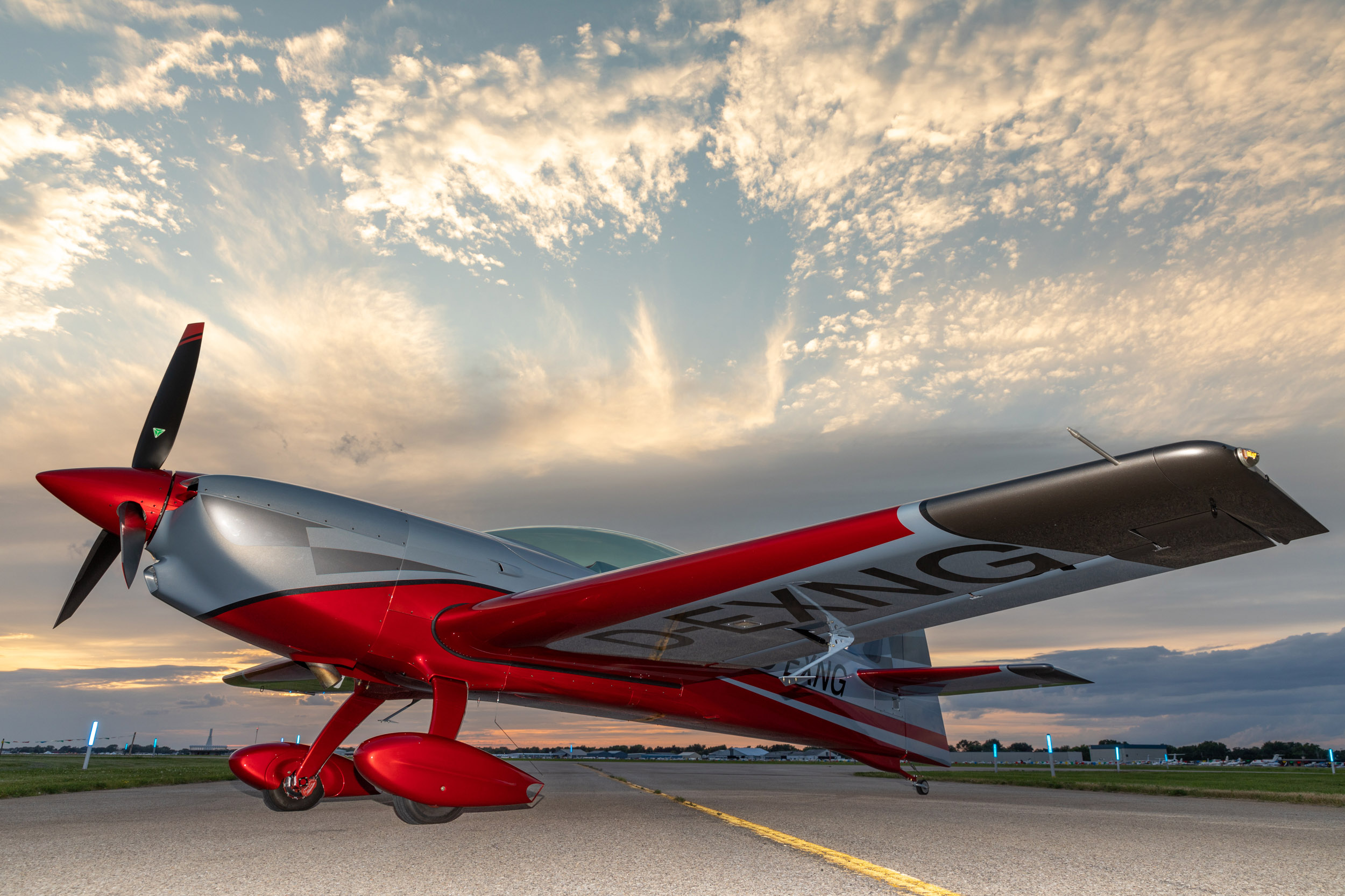 The new all-composite Extra Aircraft NG is unveiled at EAA AirVenture July 22. Photo by Evan Peers, Airspace Media.
