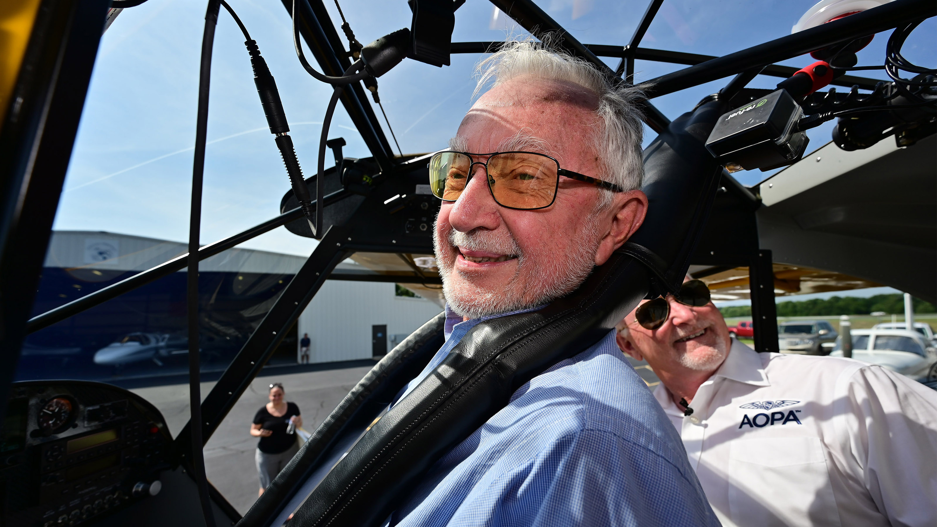Eighty-year-old student pilot and AOPA Sweepstakes Super Cub winner Wade Shealy smiles as he straps in with AOPA President Mark Baker for a familiarization flight to Lake Keowee, South Carolina, July 15. Photo by David Tulis.