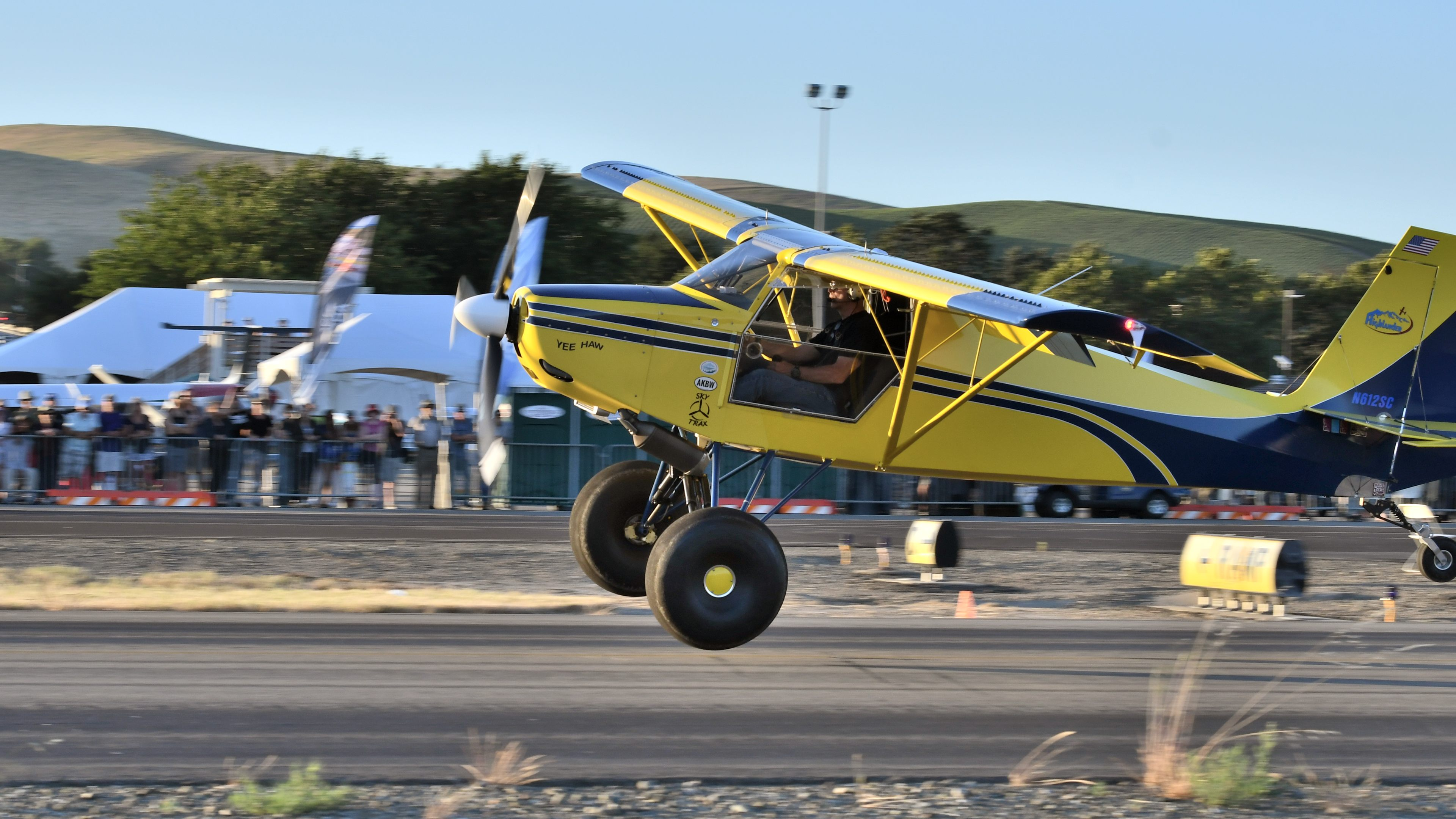 Steve Marlin makes a crosswind landing in his Just Highlander on Friday evening, June 21, during the AOPA STOL Invitational short takeoff and landing demonstration at AOPA's Livermore Fly-In. Photo by Mike Collins.
