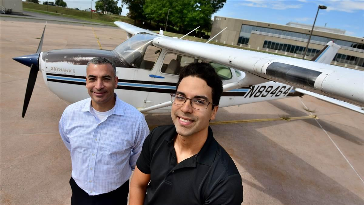 Some 19 years ago, designated pilot examiner Sharif Hidayat, left, made a career day presentation to a seven-year-old Brandon Lagos. On Aug. 10, 2019, he administered a private pilot checkride to Lagos, right. Photo by Mike Collins.