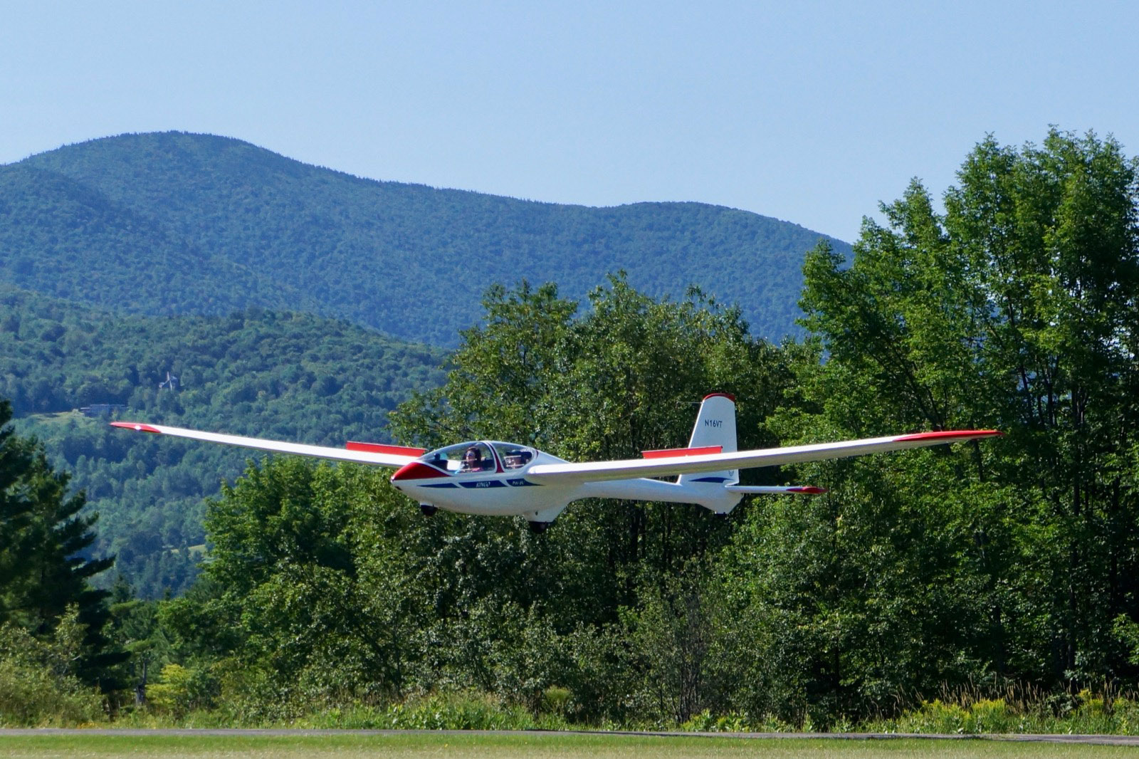 Sixteen-year-old Lauren Tulis is at the controls for a landing during a youth sailplane camp Vermont. She said glider flying required a sensitive touch and constant awareness of your surroundings. Photo courtesy of Tom Anderson.