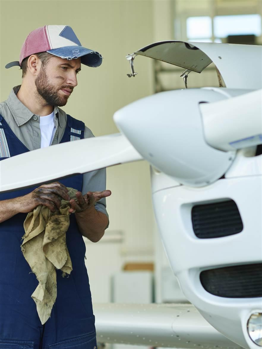 A mechanic repairs a small aircraft. iStock photo.