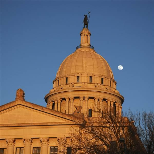 The moon rises over the Oklahoma State Capital. iStock photo.