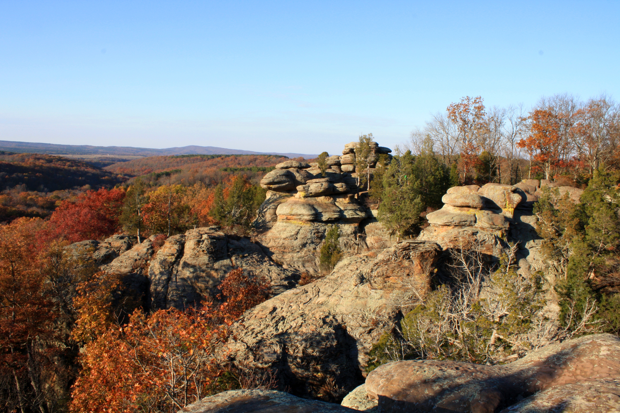 A unique rock formation at Garden of the Gods is surrounded by bright fall colors in Shawnee National Forest.