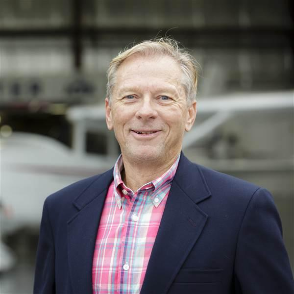 Portrait of Gary Crump, AOPA's director of medical certification with a Cessna 182 Skylane at the National Aviation Community Center. AOPA NACC (FDK) Frederick, MD USA