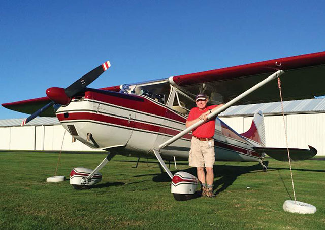 William Buchanan poses with his Cessna 170A after flying it from Arizona to his home airport, Harvey Field, in Snohomish, Washington. Photo by Jon Counsell.