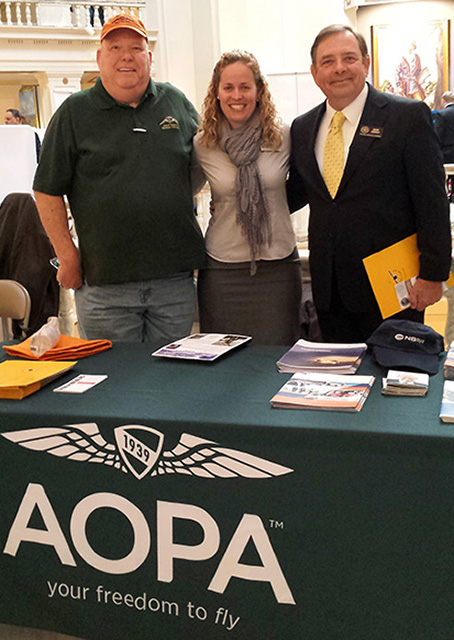 Airport Support Network Volunteer Don Heegel and the Oklahoma Aeronautics Commission's David Conway join AOPA's Yasmina Platt during Aviation and Aerospace Day at the state capitol Feb. 10. Photo by Yasmina Platt.