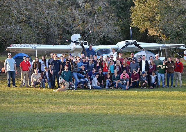 Pilots participate in Arcadia Municipal Airport's Millennial Wings Fly-In/Camp-Out at Aviation City Feb. 26-28. Friends of Arcadia Airport, including many gathered under the wings of a Grumman twin for a group portrait, worked for three years to develop the flying and camping center. Photos courtesy of George Chase.