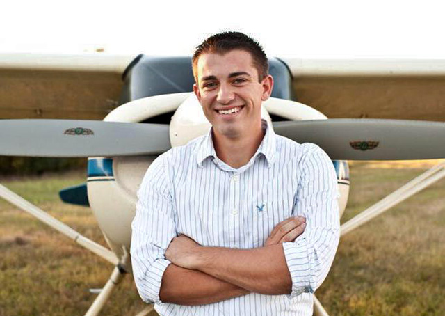 Middle Tennessee State University honors student Collin McDonald stands in front of his family's Maule MX7-160 aircraft.