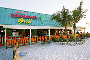 Frenchy's Rockaway Grill is an open-air restaurant with seating on the white-sand beach providing a great view of sunsets on the Gulf of Mexico.. Photo courtesy of St. Petersburg/Clearwater Area CVB.