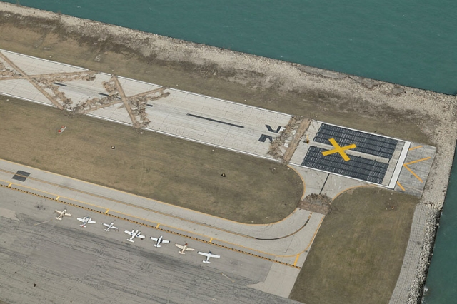 City of Chicago suddenly tears up the Meigs Field runway.