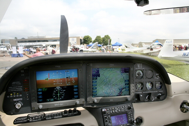 AOPA Fly-In static display ramp through the windshield of a Cirrus SR-22