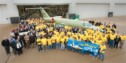 The manufacturing crew of Cessna stopped to pose with the rollout jet