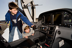 Children looking at the Let's Go Flying Sweeps plane