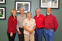 Left to right: AOPA Executive Vice President of Communications Karen Gebhart; Richard Cornelius; Bo Cornelius, Richard's wife; NASCAR driver Bobby Allison; Jim O'Daniel. O'Daniel was Cornelius' flight instructor.