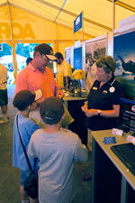 Members share GA stories in AOPA's Big Yellow Tent at Sun 'n Fun